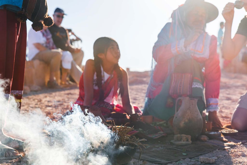A Pachamama ceremony is one of the unique things to do in the Atacama Desert.