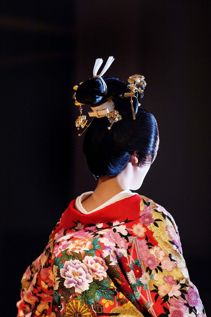 The uchikake, or bridal gown, in a traditional Japanese wedding ceremony can be pure white or colorful.
