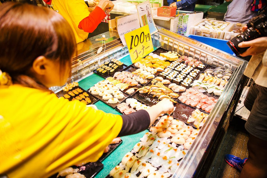 Make sure to visit a famous fish market in Japan.