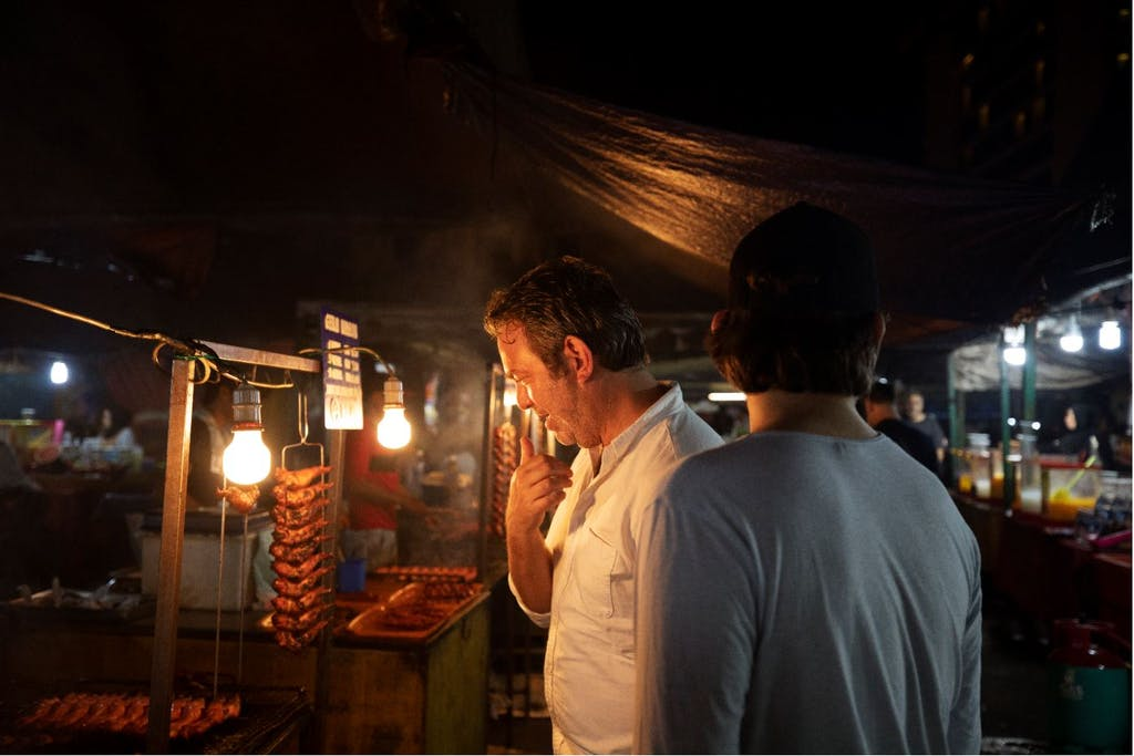 Adam Sachs in a market in kota kinabalu