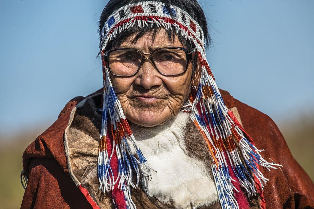 A Chukchi native performs an impromptu welcome dance for Silversea guests aboard a Russian Far East Cruise