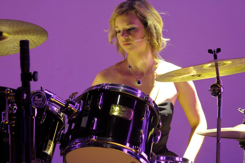 Helena Lackner playing the drums