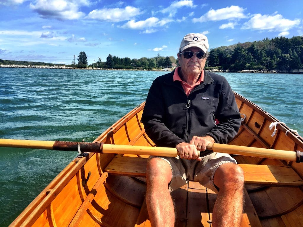 Paul Theroux rowing in Maine