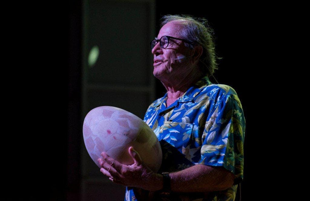 Paul Theroux with giant egg from Madagascar