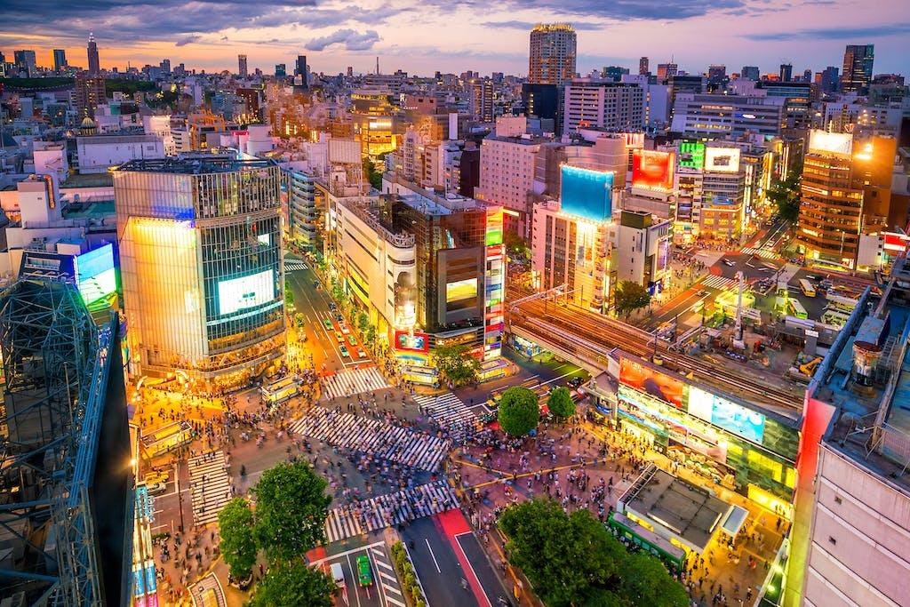Shibuya Crossing at twilight in Tokyo, Japan.