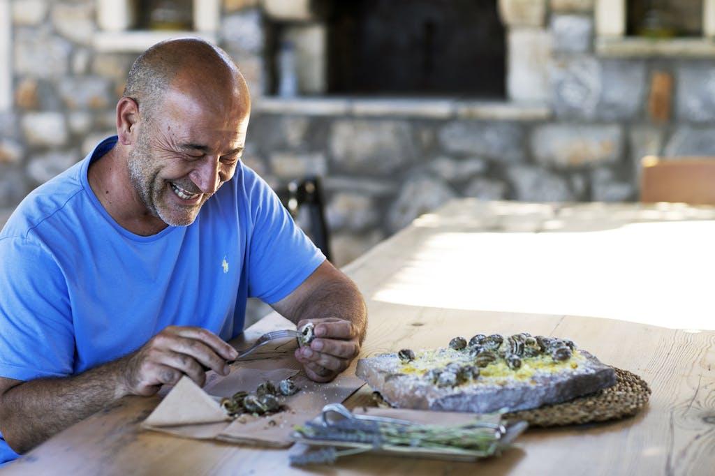 Panagiotis Magganas preparing Cretan food